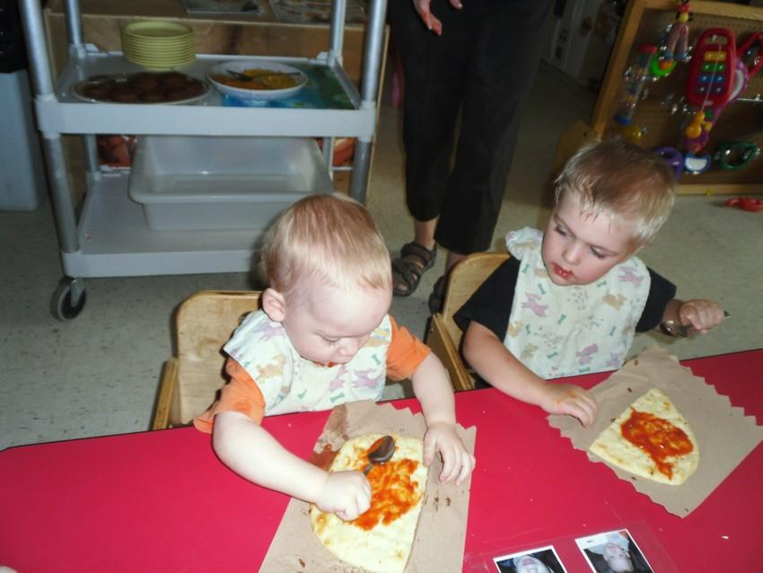 Toddlers making pizzas
